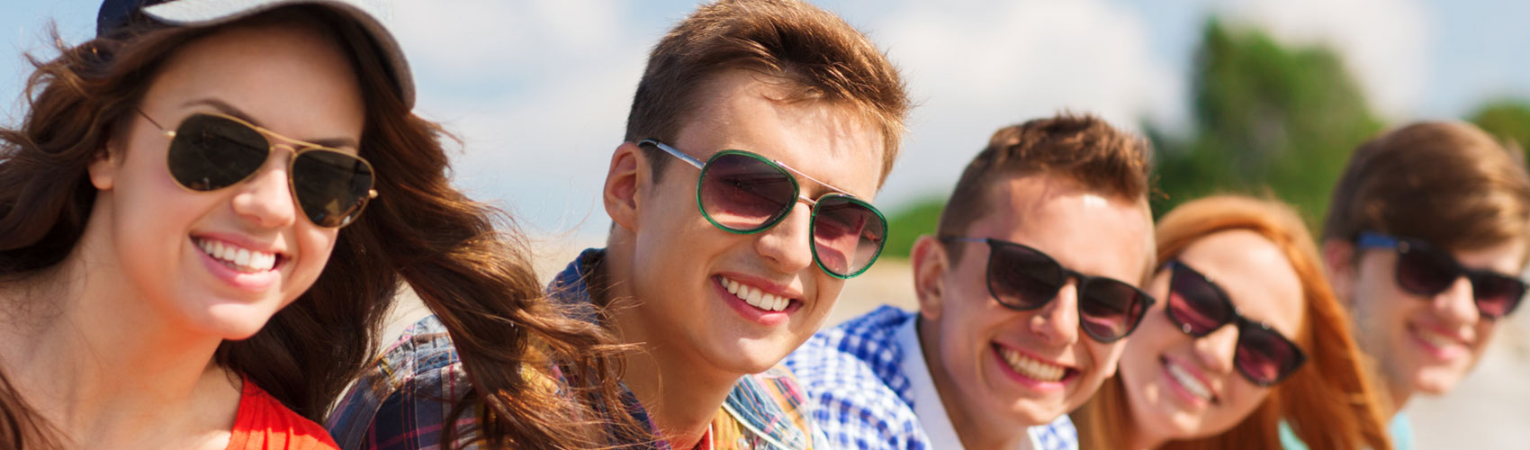 young adults wearing sunglasses